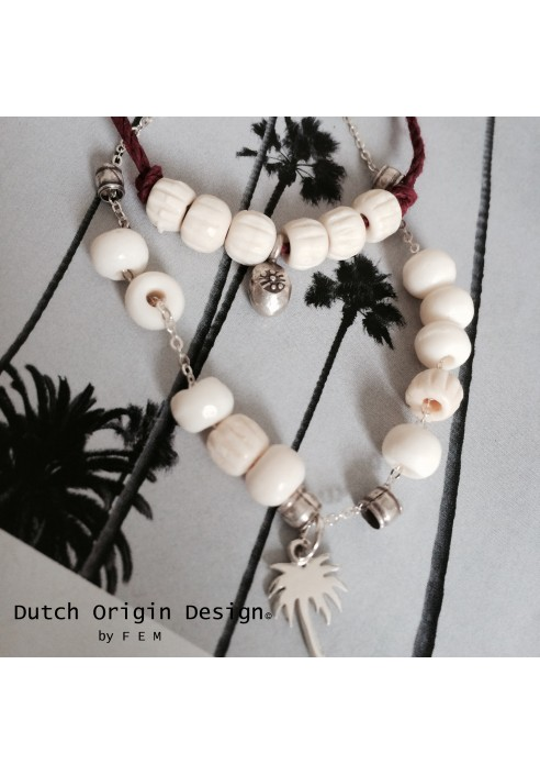 Necklace: Palm & Co €79,-